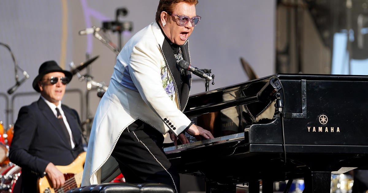 Elton John cuts concert short in New Zealand after revealing pneumonia diagnosis