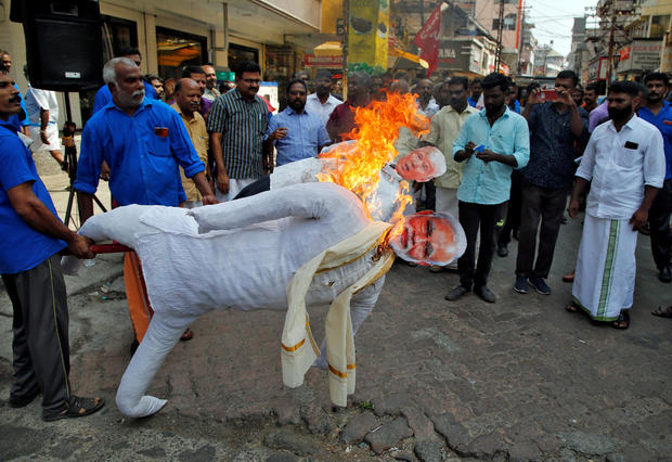 Supporters of Centre of India Trade Union (CITU) burn effigies depicting U.S President Donald Trump and India's Prime Minister Narendra Modi during a protest against Trump's visit to India, in Kochi
