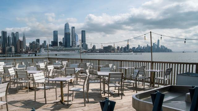 Empty chairs are seen at the deck of a local restaurant that is closed due to the outbreak of coronavirus disease (COVID-19), in Hoboken