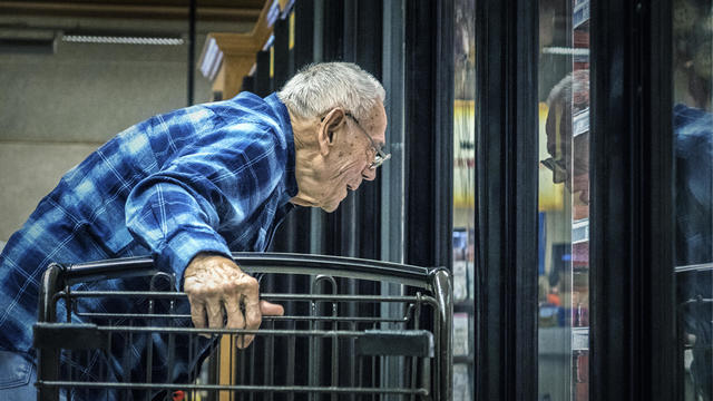Elderly Man Supermarket Grocery Shopper Looking Through Refrigerated Section Cooler Window