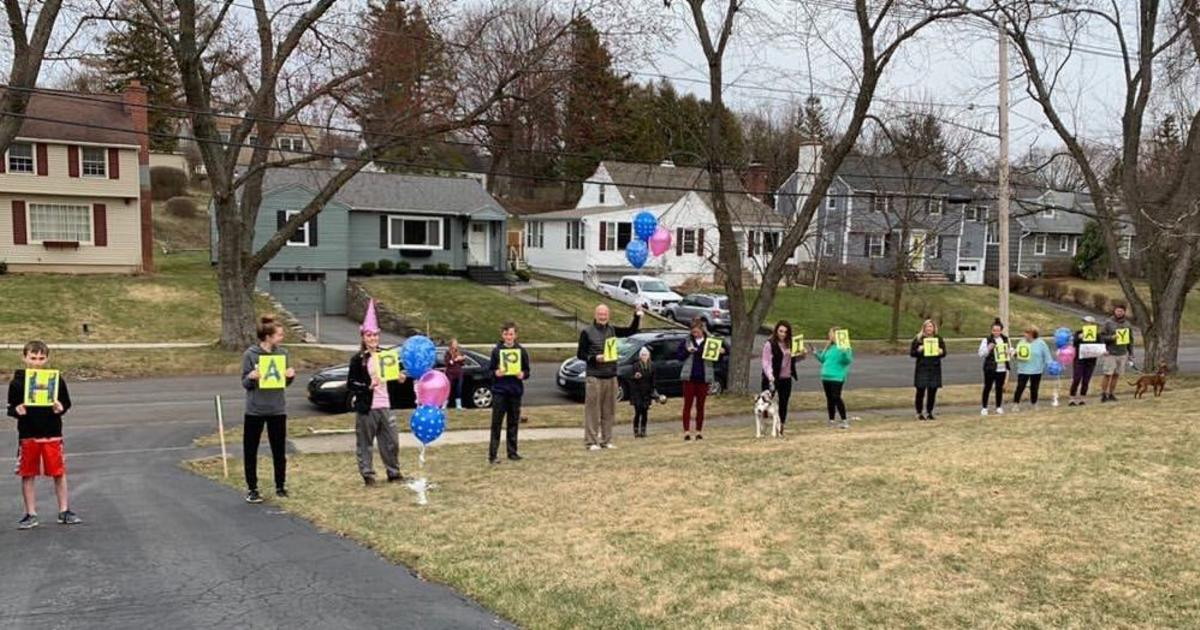 Family wishes grandma a joyous birthday — from a safe distance