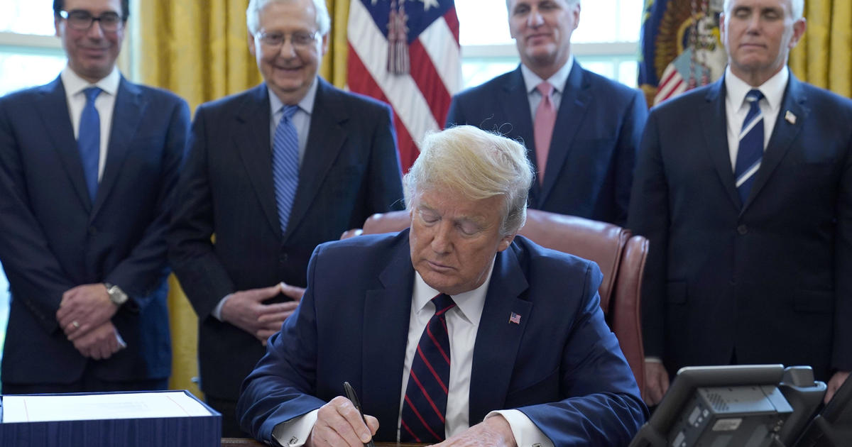Trump signs massive coronavirus relief package
