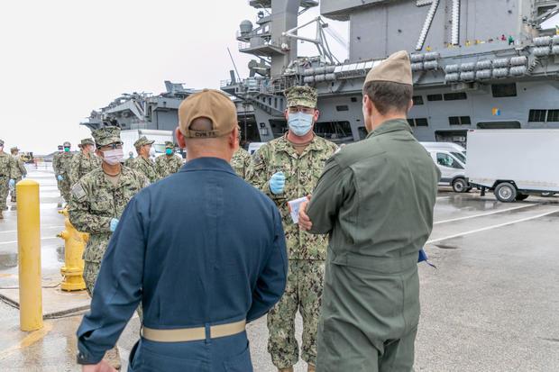 Sailors Transfer off USS Theodore Roosevelt Ashore for Quarantine