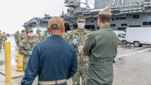 Sailors Transfer off USS Theodore Roosevelt Ashore for Quarantine