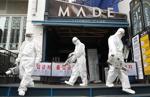 Quarantine worker spray disinfectants in front of a night club on the night spots in the Itaewon neighborhood, following the coronavirus disease (COVID-19) outbreak, in Seoul