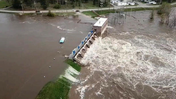 Water overruns Sanford Dam in Michigan on May 19, 2020, in this still frame obtained from social media video.