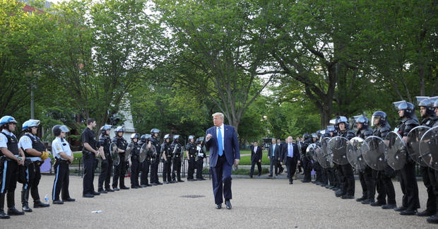 President Trump walks between lines of riot police in Washington, D.C.