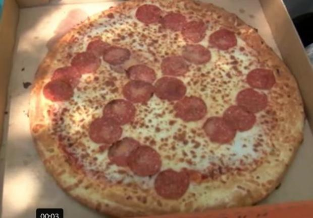 pizza-bought-on-june-27-2020-in-brook-park-ohio-little-ceasars-restaurant-with-pepperoni-placed-to-form-a-reverse.jpg