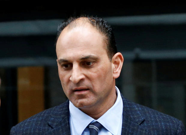 FILE PHOTO: David Sidoo, a Vancouver businessman and former Canadian Football League player, leaves the federal courthouse