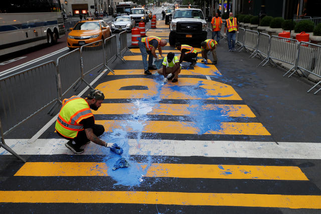 Protesters throw paint on a Black Lives Matter mural outside of Trump Tower on Fifth Avenue in Manhattan, New York