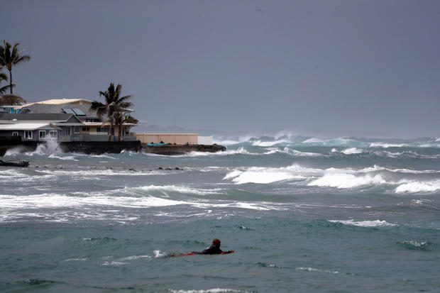 A surfer hits the waves in Hauula, Hawaii