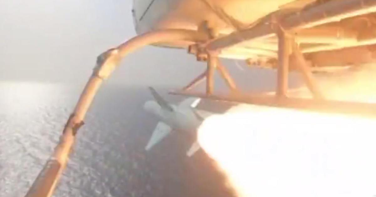 Iran fires missile at mock aircraft carrier resembling U.S. warship – CBS News