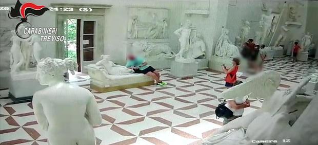 Tourist posing for photograph damages plaster cast model of an Antonio Canova sculpture