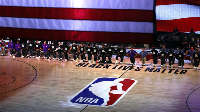 Oklahoma City Thunder and Los Angeles Lakers kneel