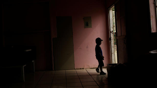 A Central American migrant child, asylum seeker sent back to Mexico from the U.S. under Migrant Protection Protocols (MPP) along his parents, is silhouetted at the Pan de Vida migrant shelter at Anapra neighborhood, in Ciudad Juarez