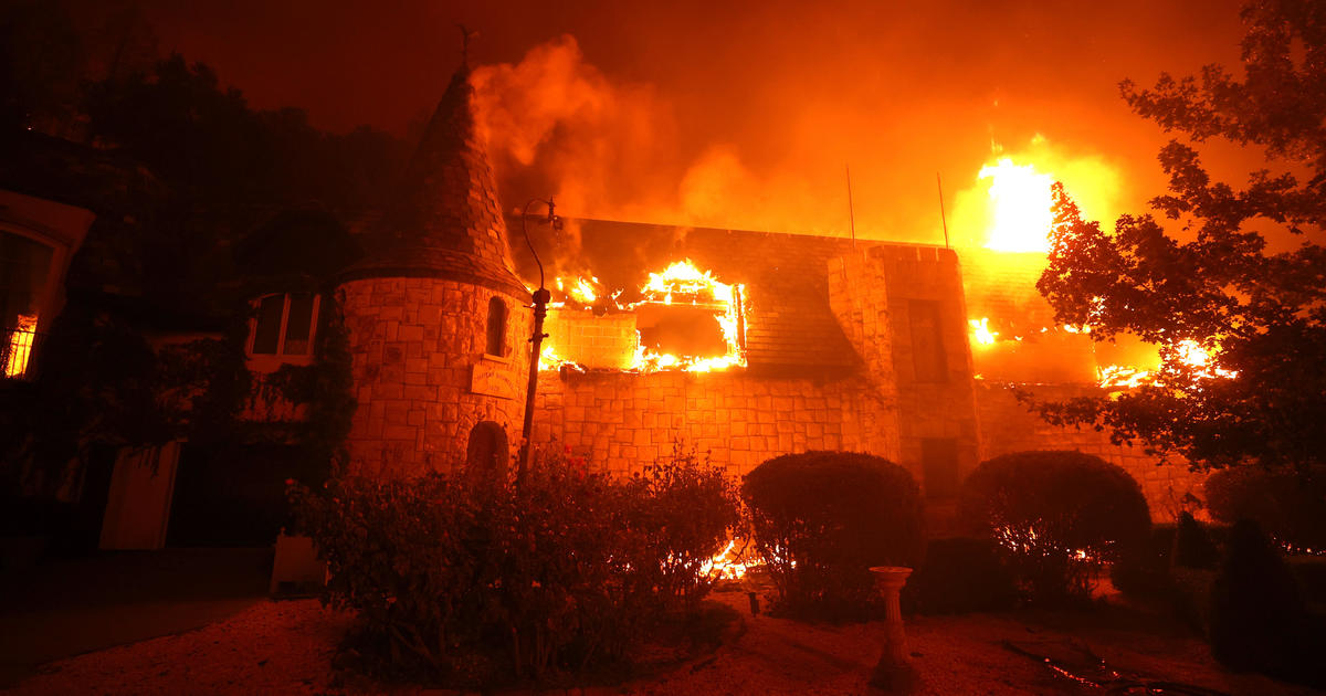 Evacuations and power cuts as wildfires char California's wine county