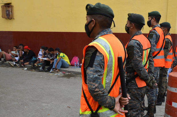 Guatemalan soldiers form a line to prevent a group of Honduran migrants who are trying to reach the U.S, from moving towards the Guatemala and Mexico border, as they sit outside the migrant shelter , in Tecun Uman