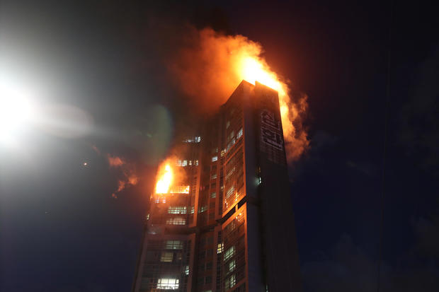 A mixed-use high-rise residential building is engulfed by a fire in Ulsan