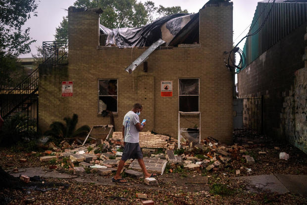Joel Martinez, who until just recently lived in the lower apartment, makes a photo of Washington Gardens Apartments after it collapsed from the winds brought by Hurricane Zeta in New Orleans, Louisiana, on October 28, 2020.