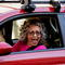 A woman cheers from her car after media announced that Democratic U.S. presidential nominee Joe Biden has won the 2020 U.S. presidential election in Madison