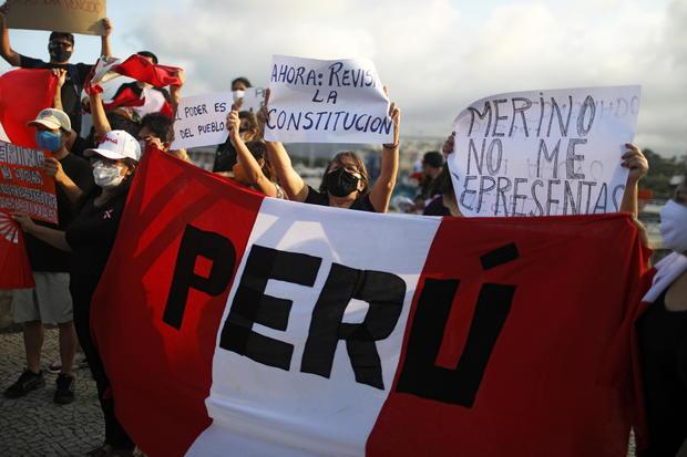 People rally after Peruvian interim President Merino resigned, in Rio de Janeiro