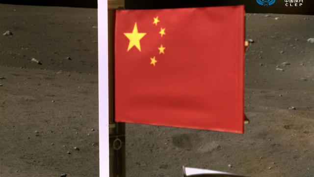 Handout image of China's national flag unfurled from the Chang'e-5 spacecraft