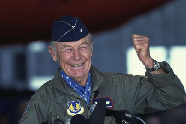 Chuck Yeager Raising Fist at Press Conference