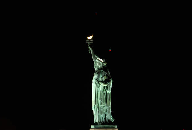Crescent Moon Sets Behind the Statue of Liberty in New York City