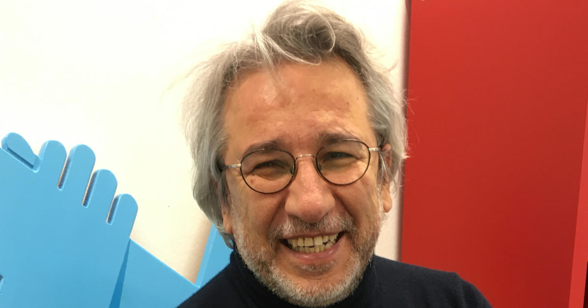 Exiled Turkish journalist Can Dündar sentenced to more than 27 years in prison on terrorism charges