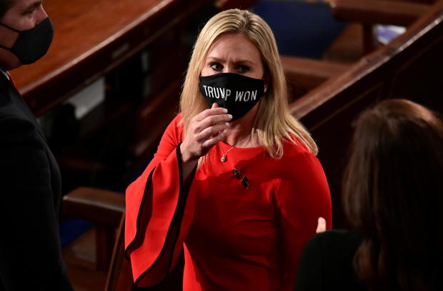 "U.S. Rep. Marjorie Taylor Greene (R-GA) wears a ""Trump Won"" face mask as she arrives to take her oath of office as a member of the 117th Congress in Washington"