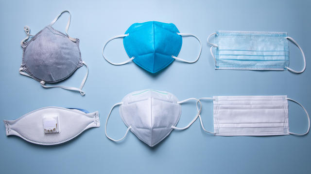 different types of protective face mask against blue background
