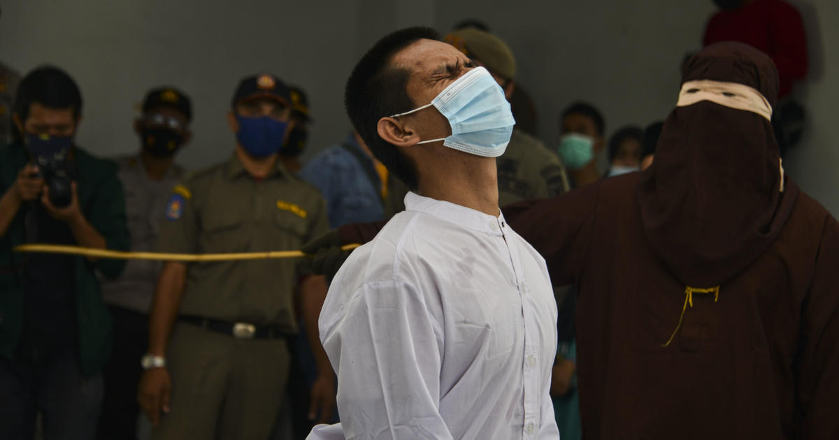 2 men publicly caned for having sex by religious police in Indonesia – CBS News