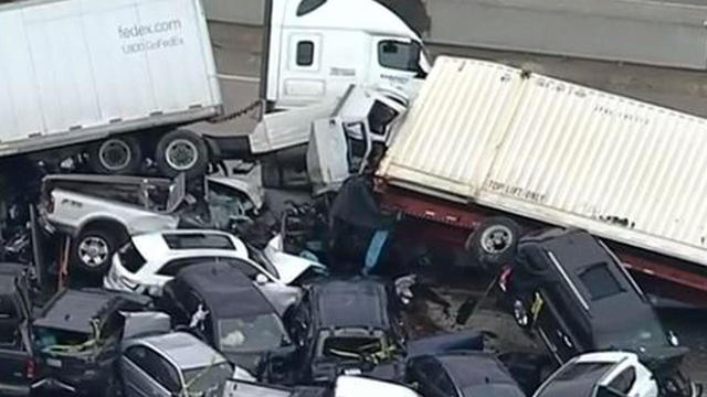 An image capture from aerial footage shows cars and trucks in a massive pileup on Interstate 35 in Fort Worth, Texas, February 11, 2021.