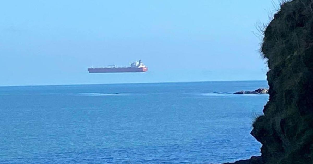 Photos appear to show a giant ship hovering over the water off the English coast - CBS News