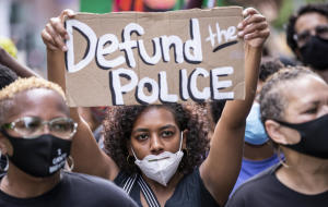 """""""Defund the police"""" became a rallying cry. What does it look like now?"""