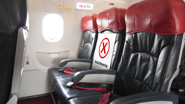 seat for passenger with space for each chair on airplane for physical distancing. airline policy about travel during coronavirus or covid-19 virus pandemic. new normal concept