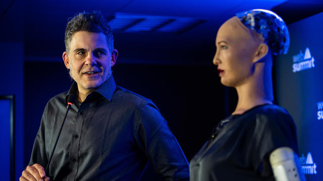 David Hanson, SingularityNET Founder (L), gives a press