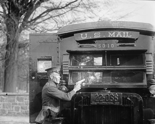 Uniformed Postal Official tests Regulation Army 44 Colt and its effect on bullet proof glass used in the new armored postal trucks