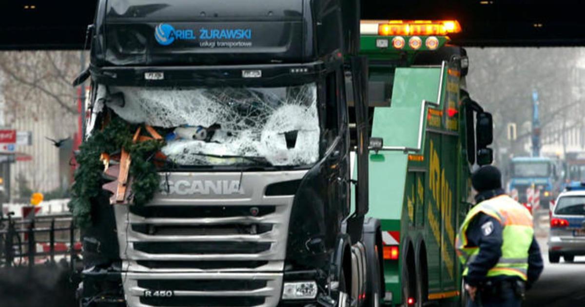 German police launch raids as terror suspect manhunt intensifies