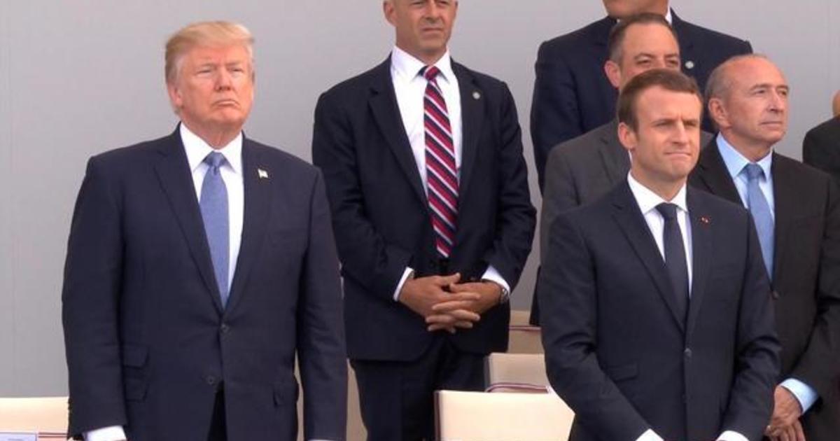 Trump attends Paris Bastille Day parade amid Russia uproar