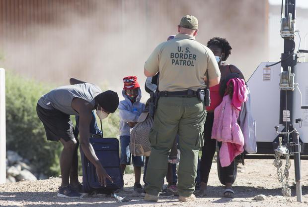 Asylum seekers cross the Arizona border