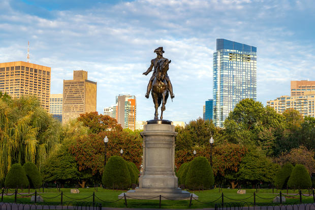 George Washington Equestrian Statue at Public Garden with office business building downtown district in Boston, Massachusetts, USA. USA tourism, modern city life, or business finance and economy concept