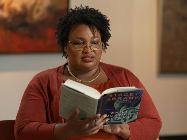 stacey-abrams-reading-while-justice-sleeps.jpg