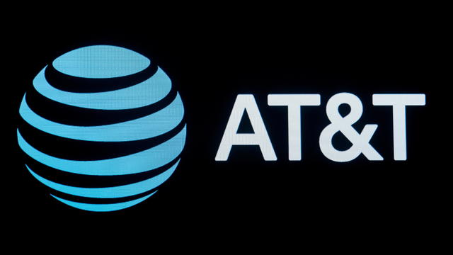 FILE PHOTO: The company logo for AT&T is displayed on a screen on the floor at the NYSE in New York