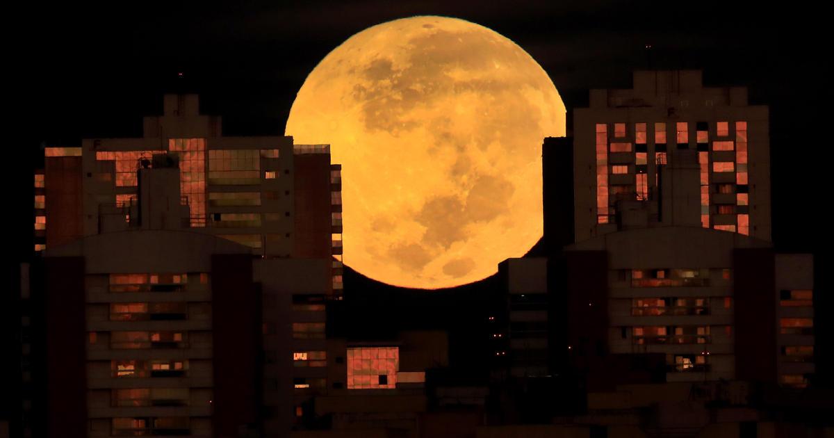 """Rare """"super flower blood moon"""" lunar eclipse captured in stunning photos from around the world"""