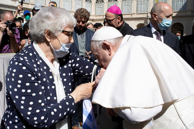 Pope meets Holocaust survivor, kisses concentration camp number tattooed on her arm