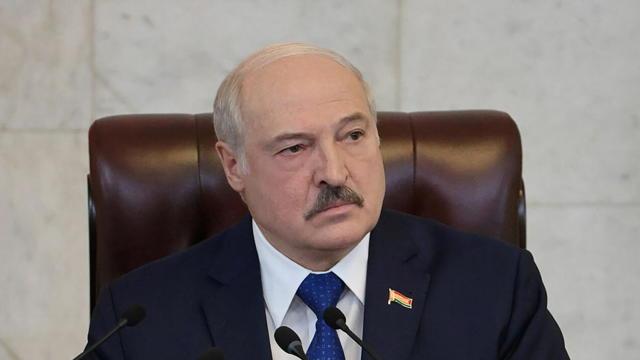 Belarusian President Alexander Lukashenko delivers a speech during a meeting in Minsk