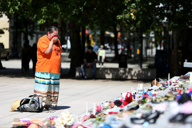 215 pairs of children's shoes set up in Vancouver as tribute after residential school discovery