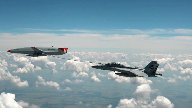 A U.S. Navy F/A-18 Super Hornet is successfully refueled by a drone in midair during a test flight June 4, 2021.