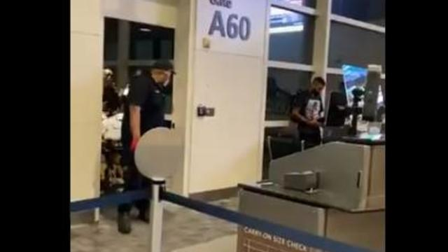 delta-flight-unruly-passenger-being-removed-in-detroit-night-of-061021.jpg